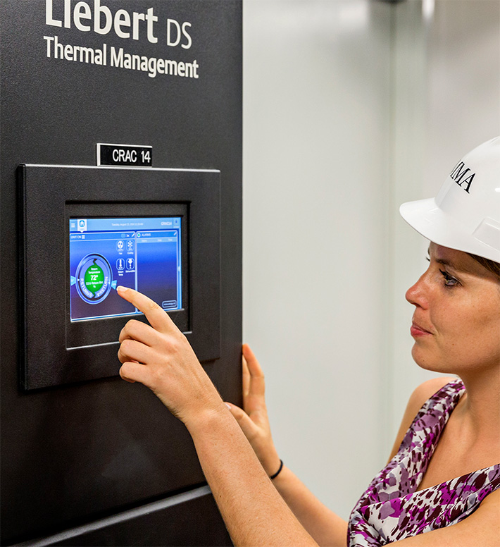 SMMA employee using touchscreen for thermal management at CVS Orlando