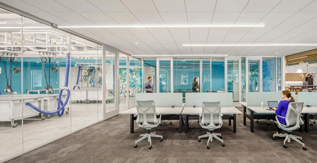 Glass wall separating lab and office space at Waters IMMERSE in Cambridge, MA