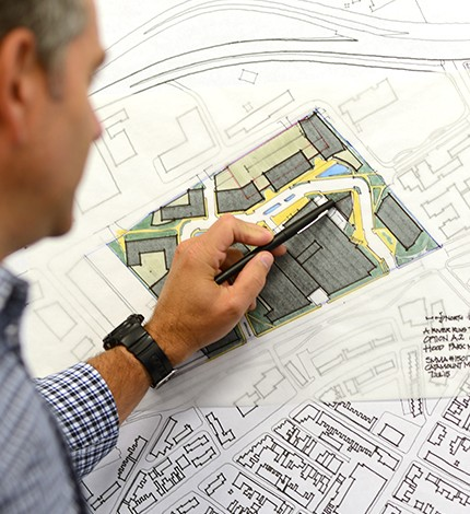 SMMA architect hand-drawing a site plan for Hood Park