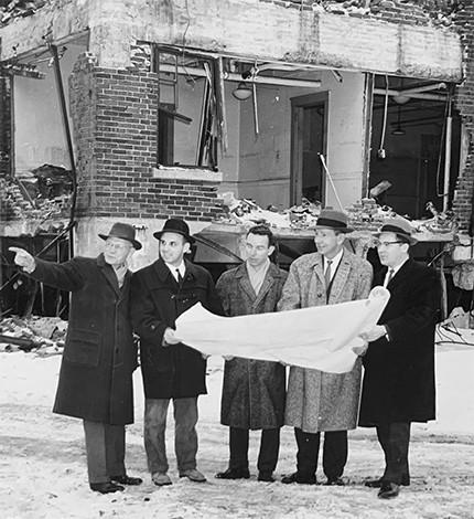 Parker Symmes, Bill Maini and Jon McKee survey a building site