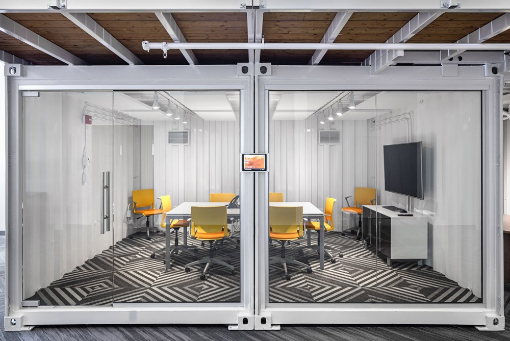 Meeting room inside a shipping container in a marketing agency office