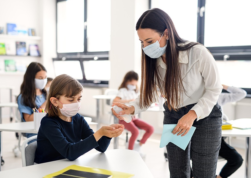Safety Protocols Post Pandemic Schools Children and teachers in masks