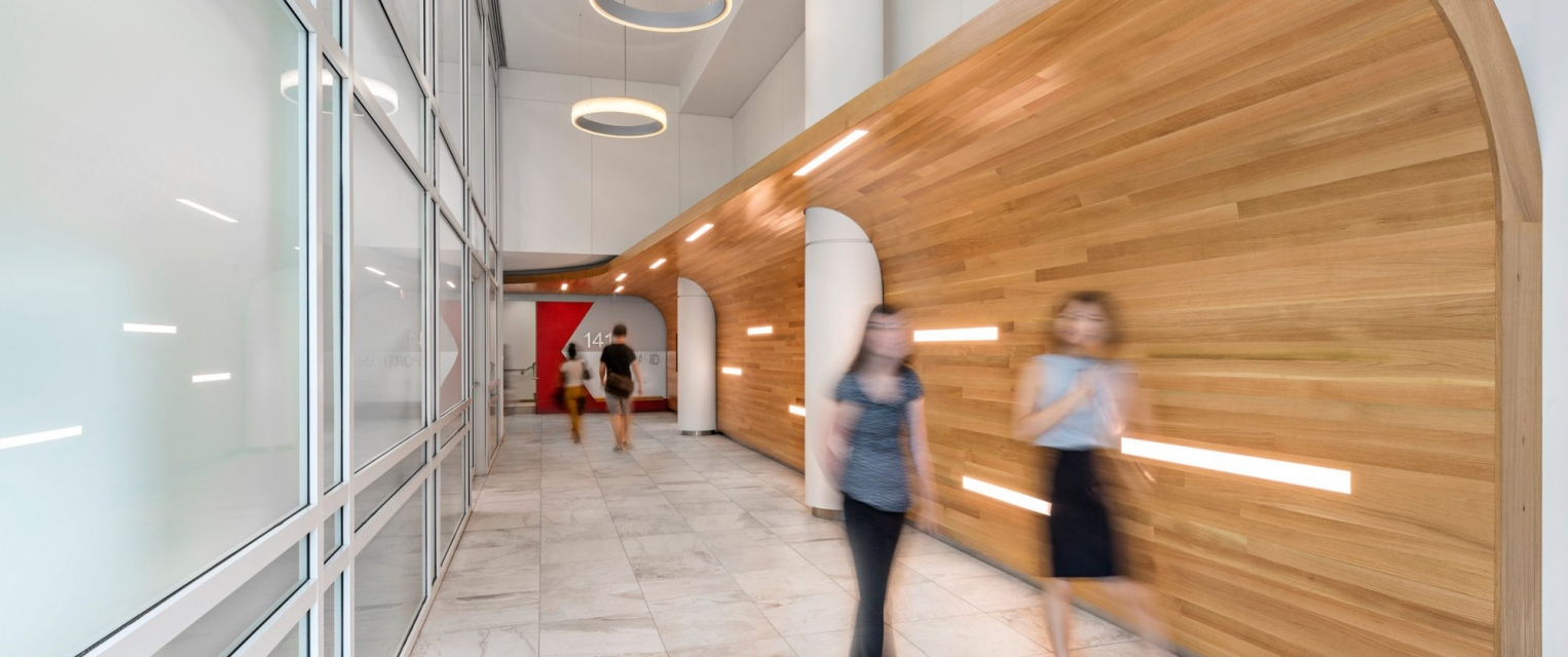 Colleagues walking through newly designed hallway